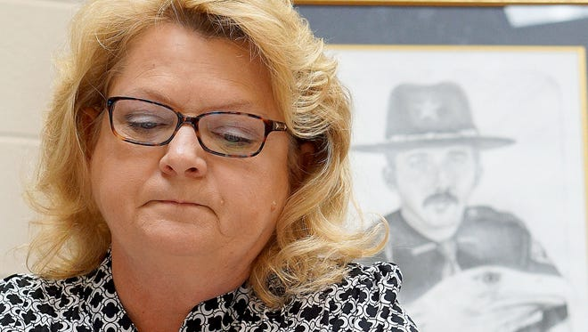 Becky Sturgill-Fossaceca worries that Carl Dean Davis, an accomplice in the killing of her late husband, could be paroled in September. Glenn Sturgill, an Ashland County sheriff's detective, was shot and killed on Aug. 2, 1982, in the line of duty.
