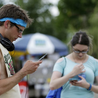 Nathan Powell and Catelyn Blevins search a map for
