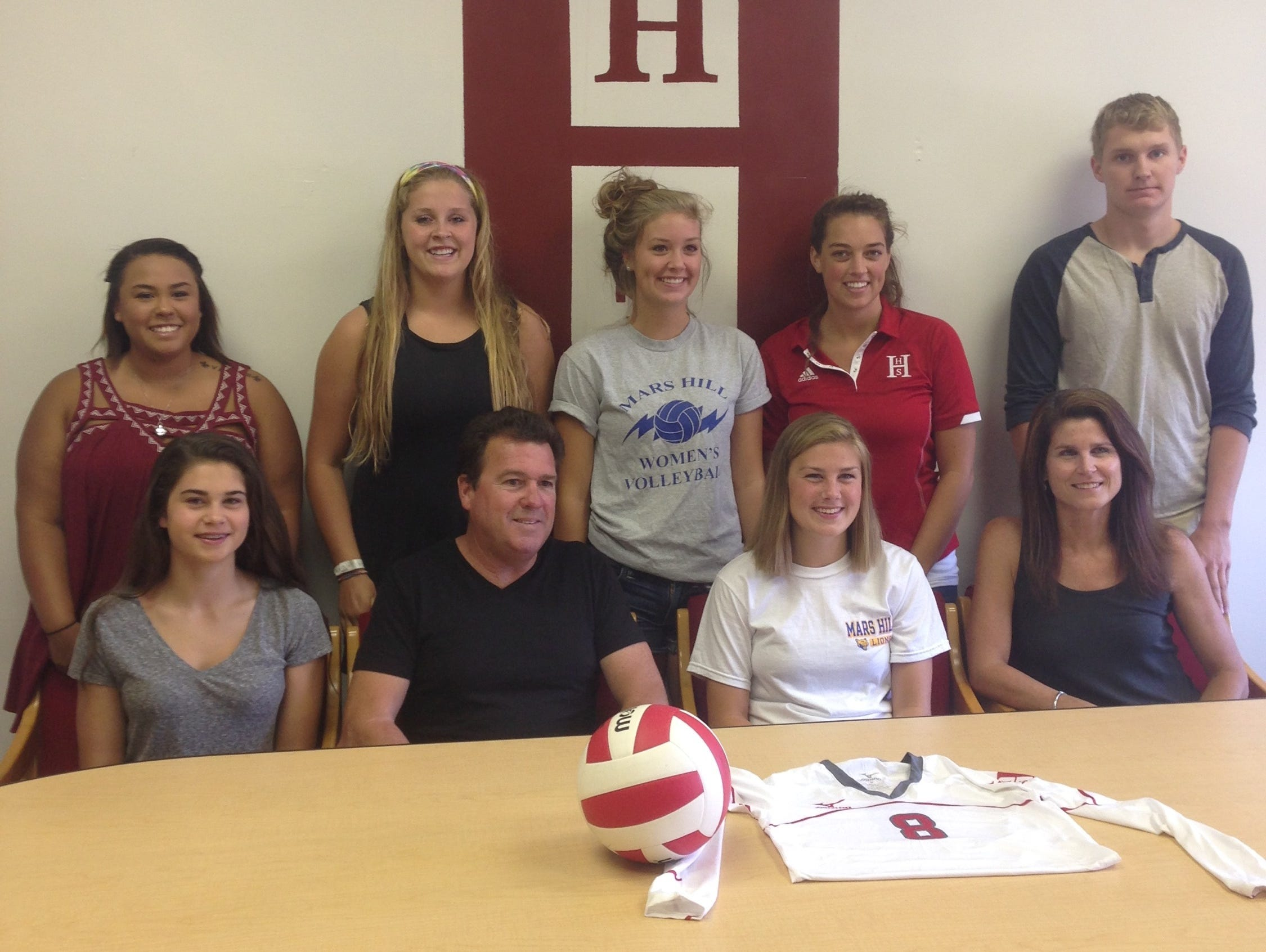 Hendersonville volleyball player Robbi Clark has signed with Mars Hill.