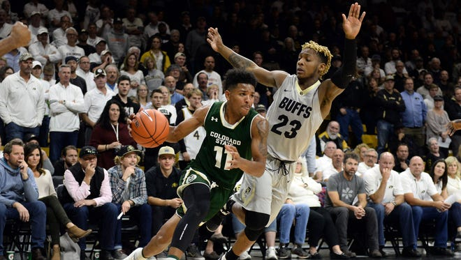 CSU guard Prentiss Nixon (11) drives the ball past CU guard Bryce Peters (23) during the Rams' 72-58 victory at Coors Events Center on Nov. 30. Columnist Mark Knudson is calling for a college basketball tournament featuring CSU and CU to be resurrected.