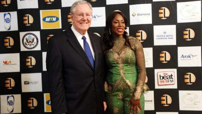 In this photo taken Sunday June 30, 2013, Steve Forbes and Mo Abudu, chief executive officer of EbonyLife TV, pose for photographers.