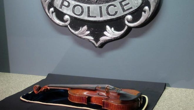 In this Feb. 6, 2014 file photo, a $5 million Stradivarius violin is displayed at the Milwaukee Police Department, a day after police recovered the instrument stolen on Jan. 27, 2014 from a concertmaster.