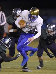 Reed's Camerson Emerson is tackled by Damonte defenders