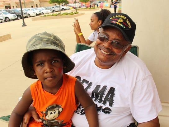 Sam Johnson holds his grandson, Max, 2, during SaturdayÕs