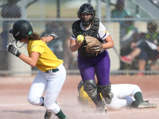 Johnston's Ally Schaer tries to get a runner out on