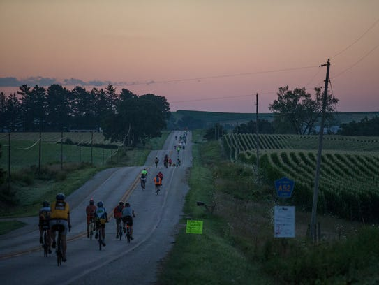 RAGBRAI riders make their way out of Waukon before