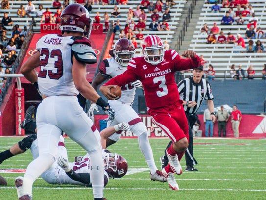 UL quarterback Jordan Davis scrambles from the pocket