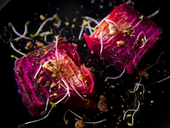 Muse's beet and goat cheese terrine has walnuts and
