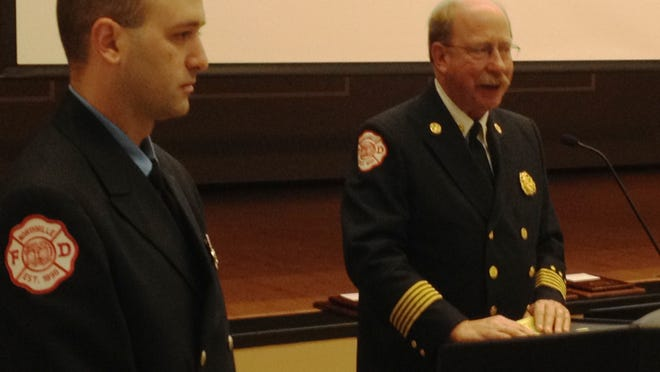 Northville City Fire Department Chief Steve Ott (right) talks about his department's public safety award recipient, Chris Fey, during a Rotary Club of Plymouth luncheon on Friday.