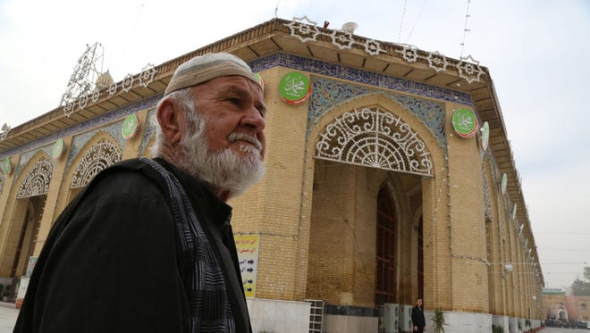 A Sunni worshiper leaves the Sunni Abu Hanifa mosque after he finds out it is closed at Azamiya area in north Baghdad, Iraq.