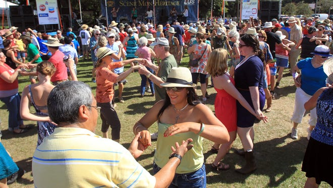 Leslie Westbrook, The Advertiser Festival-goers dance at Scene Mon Heritage as Festivals Acadiens et Créoles continues Saturday at Girard Park. Festival-goers dance at Scene Mon Heritage as Festivals Acadiens et CrÂŽoles continues Saturday, October 11, 2014, at Girard Park in Lafayette, La.