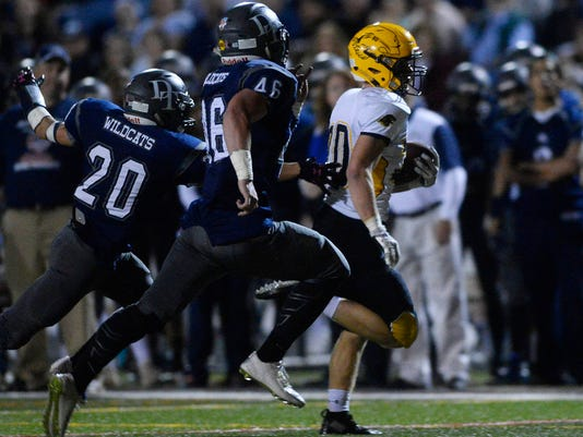 Red Lion's Alex Keough is chased down by Dallastown's Max Teyral, left, and Dallastown's Jacob Garrity during the football game at Dallastown Area High School Friday, November 6, 2015. Red Lion shut out previously undefeated Dallastown winning 26-0.