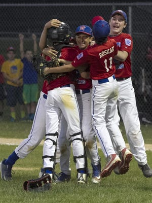 Randolph West players celebrate their 4-3 victory over TriTown in the District 1 Little League final at Freedom Park, Randolph, on Monday, July 10, 2016.