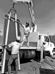 """This photograph from the book """"Wall South"""" by Art Giberson depicts the building of the monument 25 years ago."""