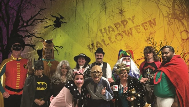 Richards & Richards employees have fun participating in a Halloween costume contest.
