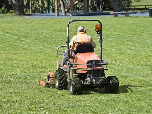 Man on Ride-On mower cutting grass