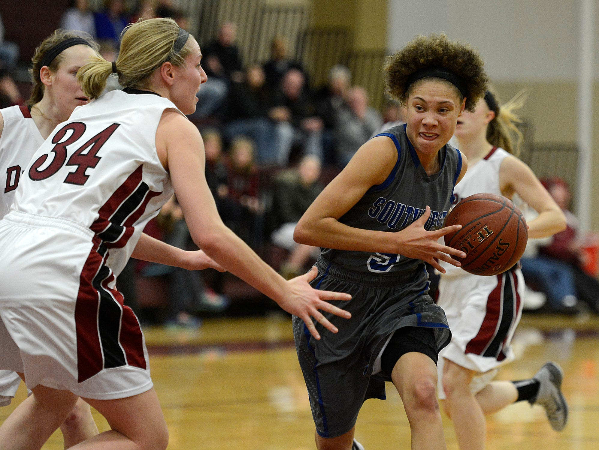 Green Bay Southwest's Natisha Hiedeman (5) drives to the basket past De Pere's Sarah Kuehn (34) in the fourth quarter at De Pere High School.