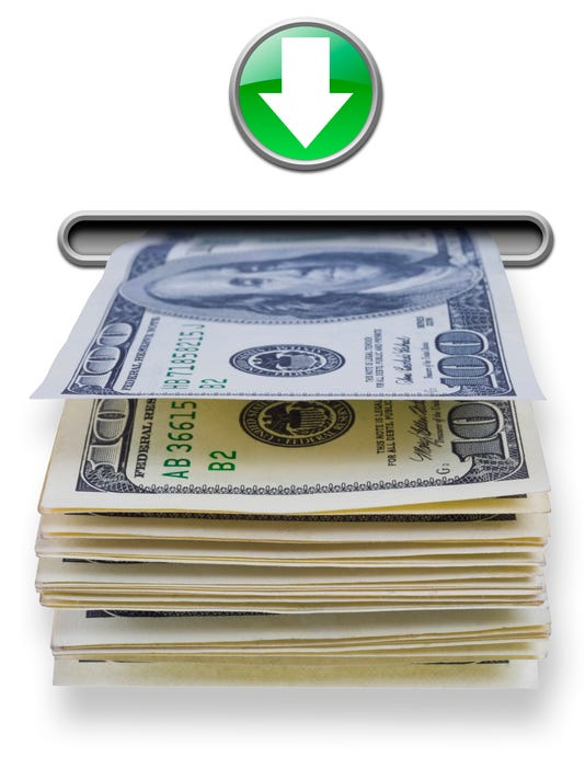 US dollar money stack dispensed from ATM cash machine