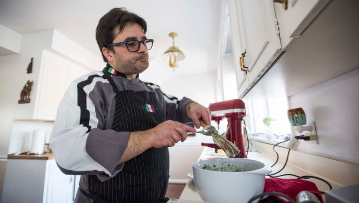 Italian chef Salvatore Arru works on a pasta dish Sunday, Jan. 16, at his home in St. Clair.