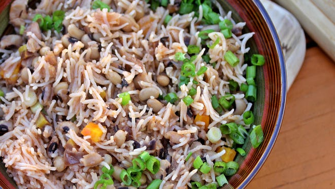 Rice Cooked with Black-Eyed Peas will keep you well nourished on a cold day.