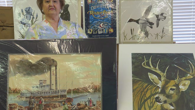 Book Room director Bobbye Legan with some of the prints and posters that will be on sale at the Book Fair.