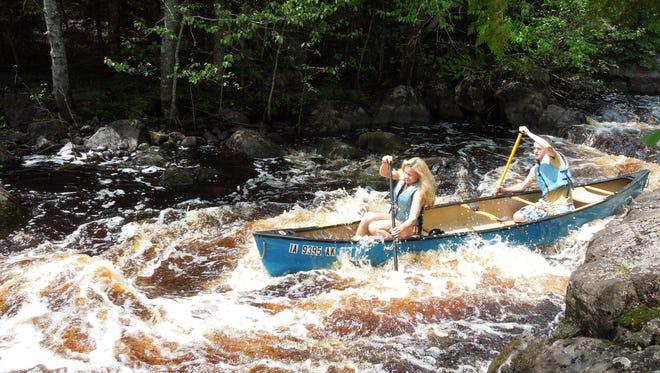 The L-C Conservation Club canoeing team of Dakota Hitchner and Riley Hall navigates rapids on the Peshtigo River.