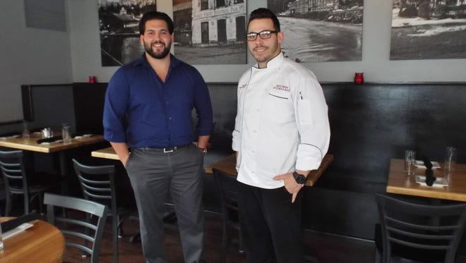 West Main Kitchen & Bar co-owners Steven W. Wrobel, left, and Anthony K. Michelin, both 25, stand in the Wappingers Falls restaurant's renovated 50-seat dining room. The business partners share a history of restaurant work and a love of good food.