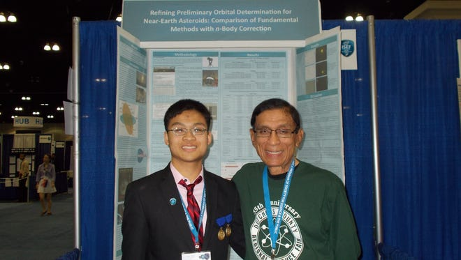 Benjamin Lei, left, stands with Maung Htoo, Ph.D., director of the Dutchess County Regional Science Fair, in front of Lei's winning project at the International Science & Engineering Fair in Los Angles in May.