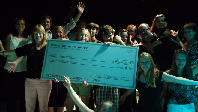 From left are Micki Strawinski, Cynthia Prosser Phillips, Nick Prosser, Noel Katherine Phillips and (bottom right) Sarah Prosser of the Ellis L. Phillips Foundation, surrounded by Cocoon performers, who presented the check in a live-music improvisation along with audience participation.