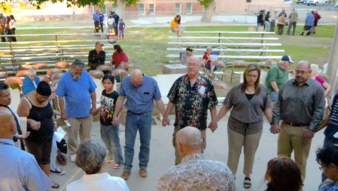 Church leaders of different denominations participated in a prayer circle during the 2017 National Day or Prayer local event. This year's event will be held at 6:30 p.m. on Thursday, May 3 at Luna County Courthouse Park.