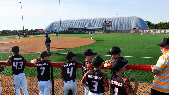 A Washington travel baseball team watches a game at the Louisville Slugger Sports Complex in 2018. The complex reopened last weekend for the first time since closing in March because of the COVID-19 pandemic.