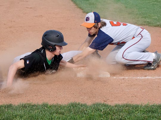 Clear Fork's Mason Cox slides safely into third base before Matt Hardy of Galion can apply the tag Monday afternoon at Madison High School.