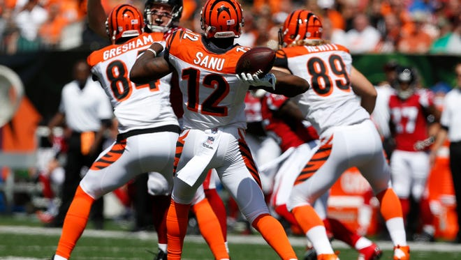 Bengals wide receiver Mohamed Sanu throws the ball for a first down against the Atlanta Falcons on Sunday at Paul Brown Stadium.