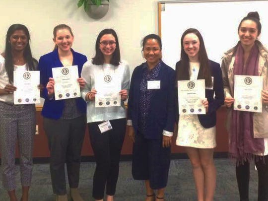 Displaying their certificates of participation with their AP Chemistry teacher Reina Colon are: Trisha Parayil of Bridgewater, Victoria Gainey of Springfield, Jacqueline McNulla of Plainfield, Catherine Lawlor of Summit, and Isabel Velarde of East Brunswick.