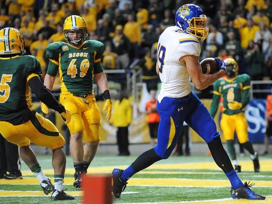 SDSU's Jake Wieneke (19) catches a touchdown pass during the second half of an FCS playoff game against NDSU on Saturday, Dec. 6, 2014, in Fargo, N.D. The Bison defeated the Jackrabbits 27 to 24.