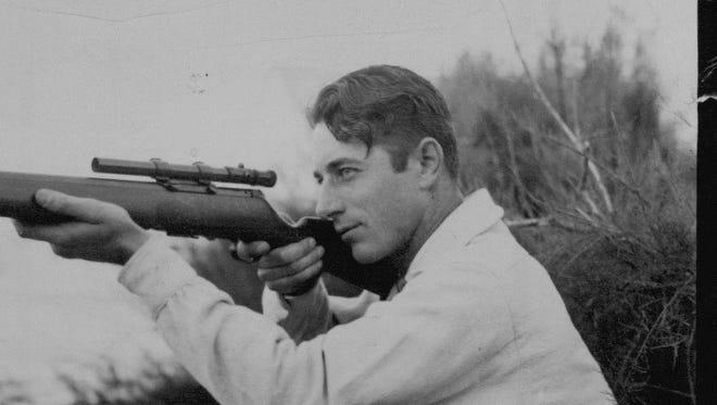 An undated photo of William R. Weaver using his Weaver Scope.