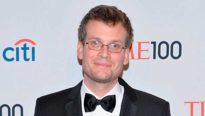 Indianapolis-based author John Green pauses for photographs on tonight's Time 100 red carpet.