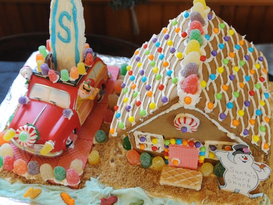 A gingerbread creation by Loretta Collet is shown at