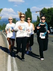 In this 2014 file photo, Run for the BEACH runners enjoyed themselves while running down Sudderth Drive. Saturday is the inaugural Run for the Mountain.