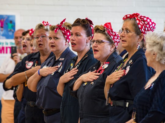Rosie the Riveter tributes sing the National Anthem.