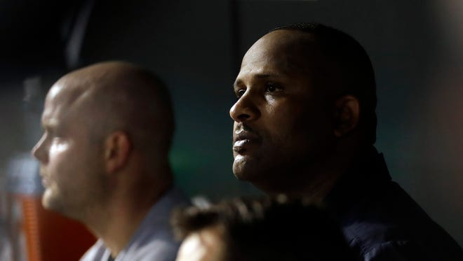 New York Yankees starting pitcher CC Sabathia, right, sits in the dugout in the sixth inning of a baseball game against the Baltimore Orioles in Baltimore, Saturday, Sept. 3, 2016.