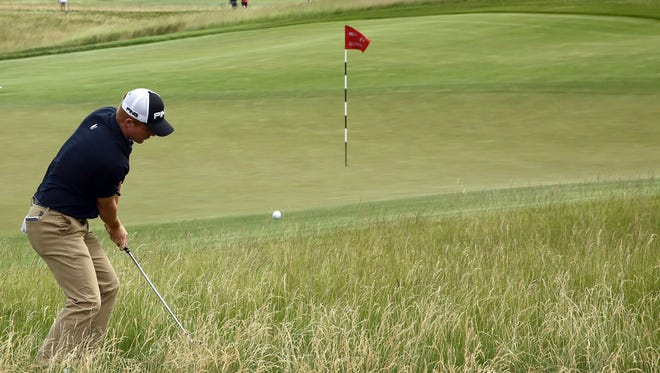 Jun 16, 2017: Mason Andersen chips up out of the high grass onto the 11th green during the second round of the U.S. Open golf tournament at Erin Hills.