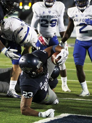 Wolf Pack running back Kelton Moore scores a touchdown in the fourth quarter against Air Force last week.