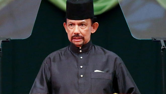 Brunei Sultan Hassanal Bolkiah delivers a speech during the official opening of the Majlis Ilmu 2013 in Bandar Seri Begawan, Tuesday.
