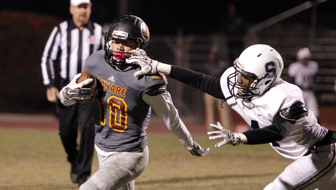 Tulare Union's Kazmeir Allen gets face masked against Sunnyside during a Division II quarterfinal high school football game held in Tulare, Calif., Friday, Nov. 18, 2016.