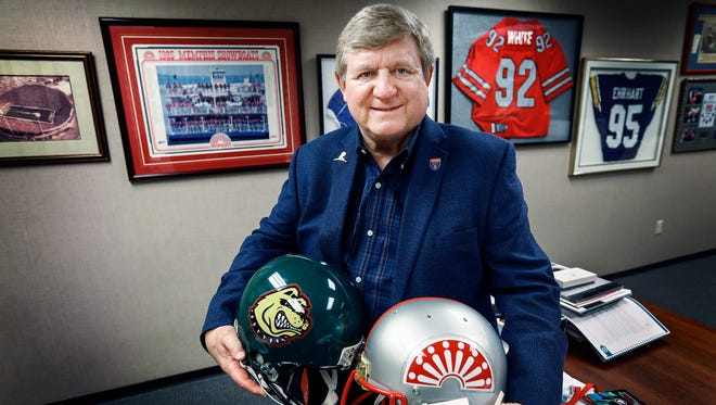 AutoZone Liberty Bowl Executive Director Steve Ehrhart sits in his office with sports paraphernalia from his days as the general manger of Memphis' former pro football teams.