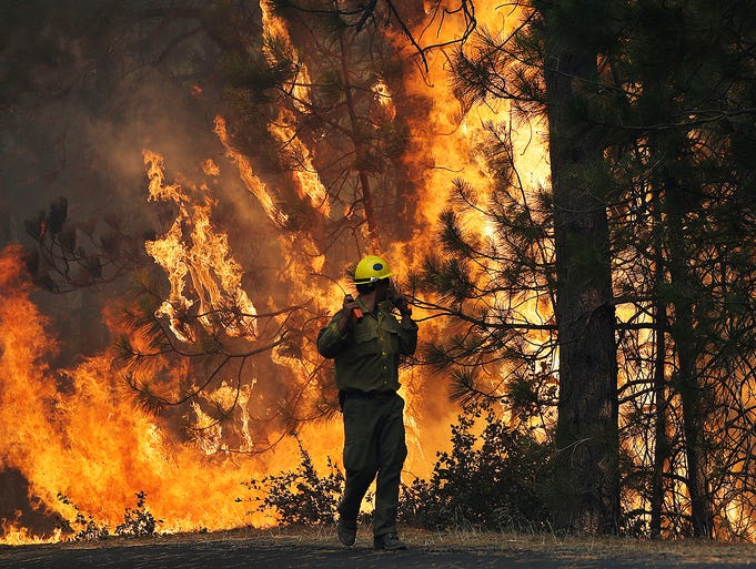 Firefighter A.J. Tevis works at the Rim Fire on Aug. 25 near Yosemite National Park, Calif. The fire has burned about 134,000 acres, an area about the size of Chicago.