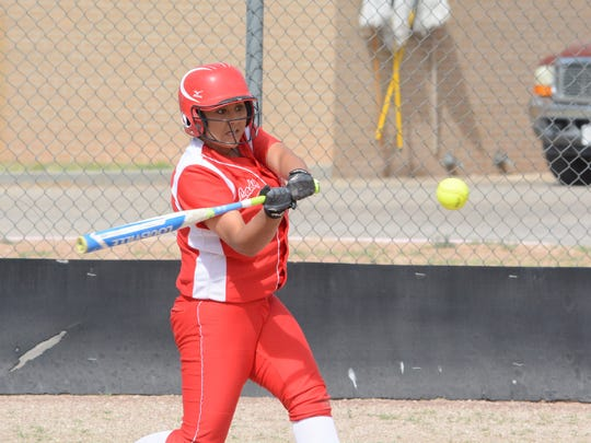 Loving's Andrica Gomez makes contact at the plate in game one Tuesday against Tularosa.