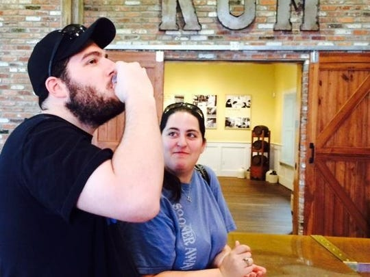 Anthony Airola and Kaitlin Bucher of Houston sample Louisiana Spirits products after the tour.