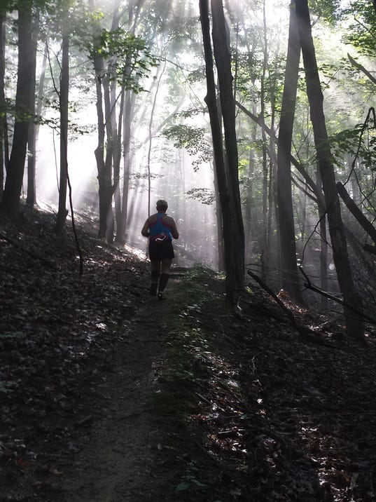 A runner on Letchworth State Park Trail 16 during the Dam Good trail race on Aug. 24. Photo by Kyle Hickerson.